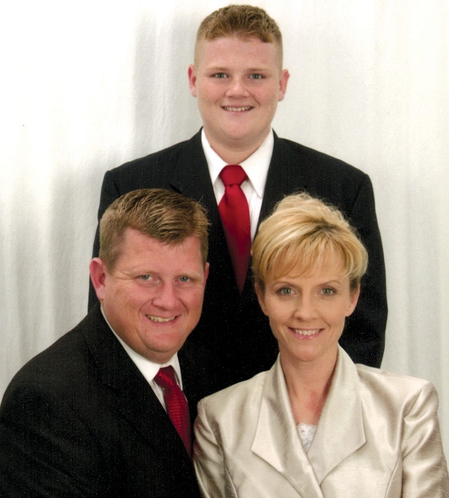 Amy Rhudy and husband, Lee (left), and their son, Nathan