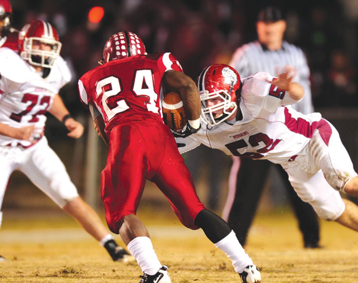 Oneonta's Thomas Boyd launches himself at Anniston running back Troymaine Pope during last Friday night's 4A semifinal. The Redskins earned a 21-14 victory over the Bulldogs and will play Jackson in the 4A state championship game Friday at 11 a.m. at Bryant-Denny Stadium in Tuscaloosa. Oneonta fans are invited to a pep rally tonight – Fill the Gil(breath) Stadium – at 7:30. Fans are also urged to get to Tuscaloosa early Friday for the Walk of Champions outside the stadium at 8:55. – Rob Rice