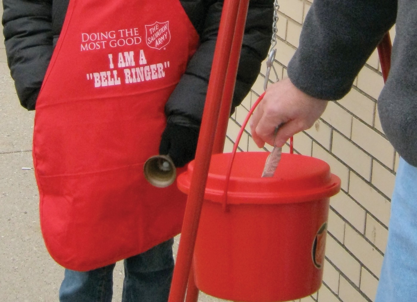 Salvation Army bell-ringers are instructed not to take money by hand from donors, but to allow them to deposit it directly into the collection kettle.