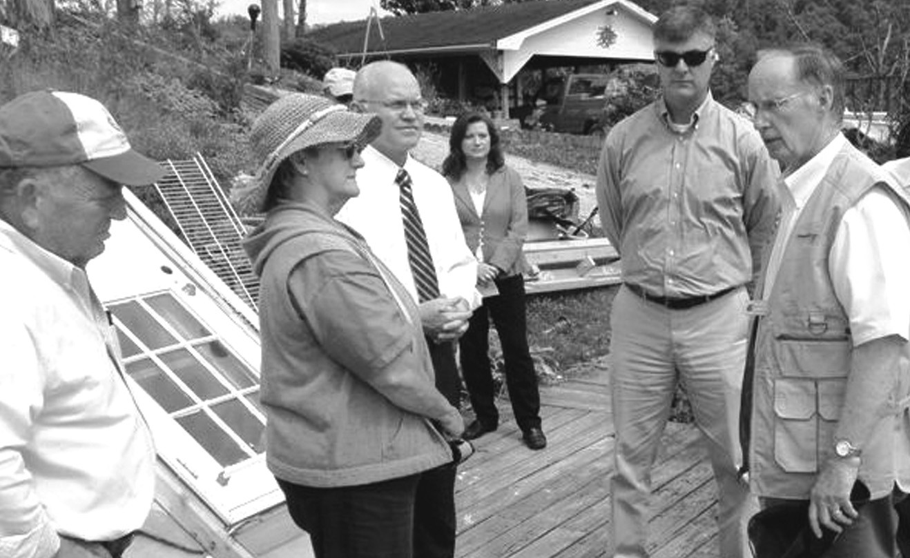 During a stop in Hayden as part of his tour of storm damage in Blount County, Gov. Robert Bentley chats with (from left) Jerry and Jane Ferguson, Judge David Standridge and his wife Danna Standridge, and Sen. Scott Beason. Photo courtesy Max Armstrong, Blount County EMA Director