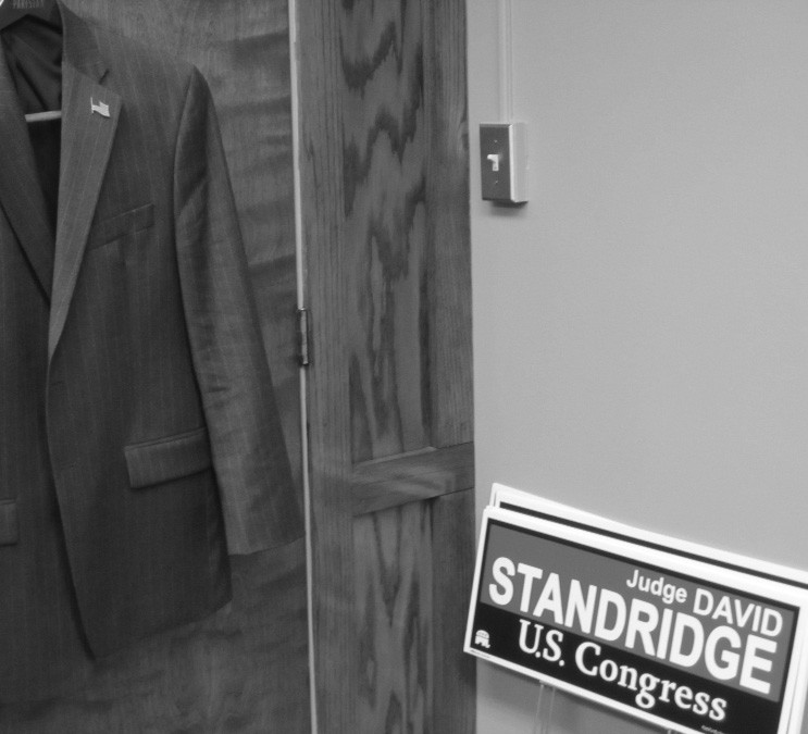 Sign of the times. Out of sight, but close at hand, in the office of Probate Judge David Standridge, are two symbols of his Congressional campaign: the political signs that supporters request at many campaign stops, and the much-traveled suit coat that gets only short breathers on its hook behind the door.