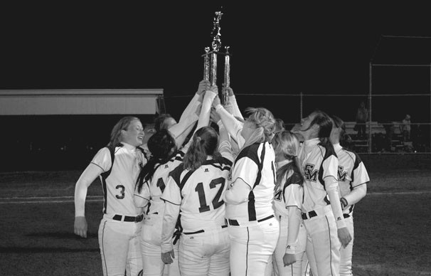 Lady Bulldogs celebrate as they receive the DAR Tournament trophy.