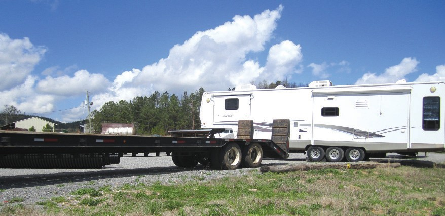 Lowboy trailer and fifth-wheel camper: two of nearly a dozen pieces of heavy equipment stolen in Blount County and out of state, recovered by Sheriff's Department investigators in the Cleveland area.