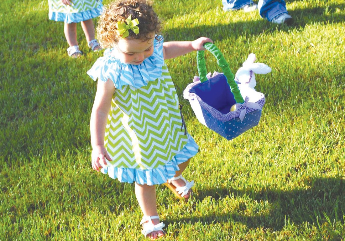 Carsyn Cornelius, daughter of Matthew and Brooke Cornelius of Oneonta, is looking for just the right egg to fill her basket during last Saturday's Breakfast with the Bunny at Oneonta Rec Park. The event, organized by the Oneonta Business Association, was directed by members Kathy Young, Shannon Longshore, and Kristen Gargus. Sponsors of the event included McDonald's, Judge Sherry Burns, The Playroom, attorney Bonnie Peavy, Jack and Jill Inflatables, and The Gym. Several of the businesses donated prizes for drawings, and McDonald's supplied pancake breakfasts for the little ones. – Rob Rice