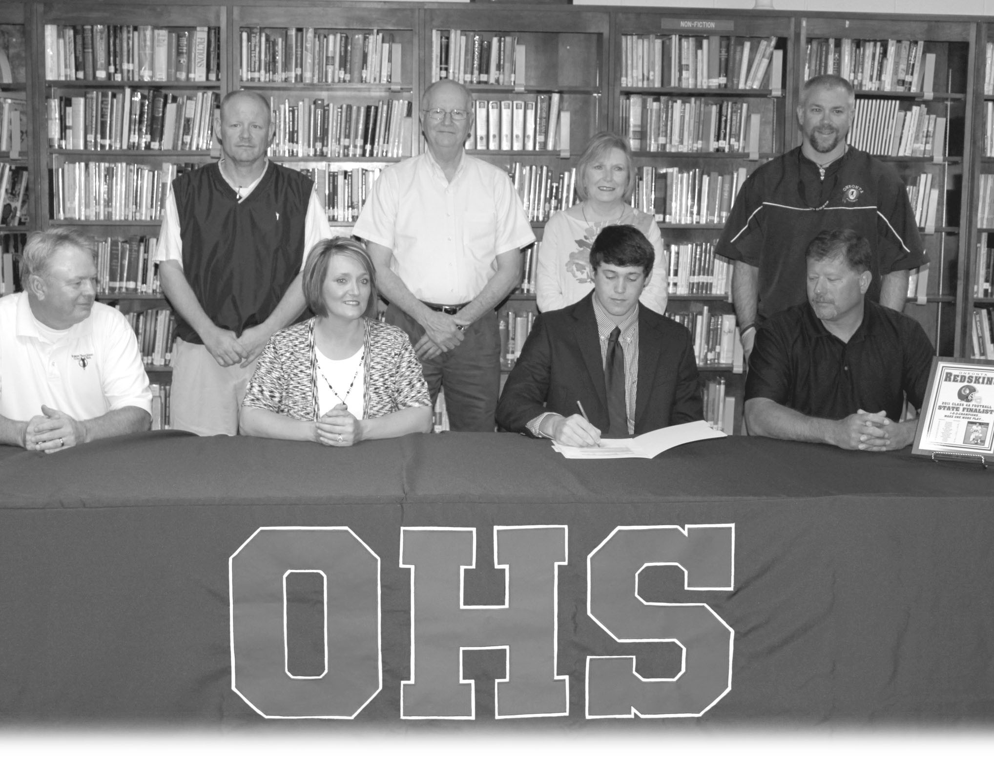 Oneonta quarterback Schyler Walker has signed a scholarship with Southwest Mississippi Community College. Pictured above are (bottom row, left to right) Oneonta head coach Don Jacobs, parents Tammy and John Walker; (top row) Oneonta assistant coach Phil Phillips, grandparents Johnny Walker and Betty Moss, and Oneonta assistant coach David Elrod. Walker, a two-year starter for the Redskins, finished his career as the Redskins' all-time leading passer. As a senior, Walker completed 201 of 360 passes for 2919 yards with 38 touchdowns and 11 interceptions. He also rushed for 419 yards and seven touchdowns on 71 carries and caught two passes for 95 yards and a score. Oneonta finished the year 12-3 and was runner-up in Class 4A after a 42-28 loss to Jackson in the title game.
