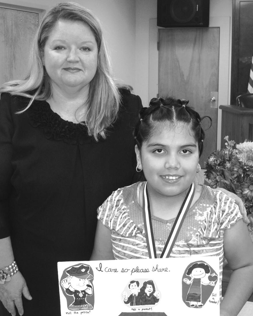 Overall winner Erika Gonzalez with Judge Sherry Burns
