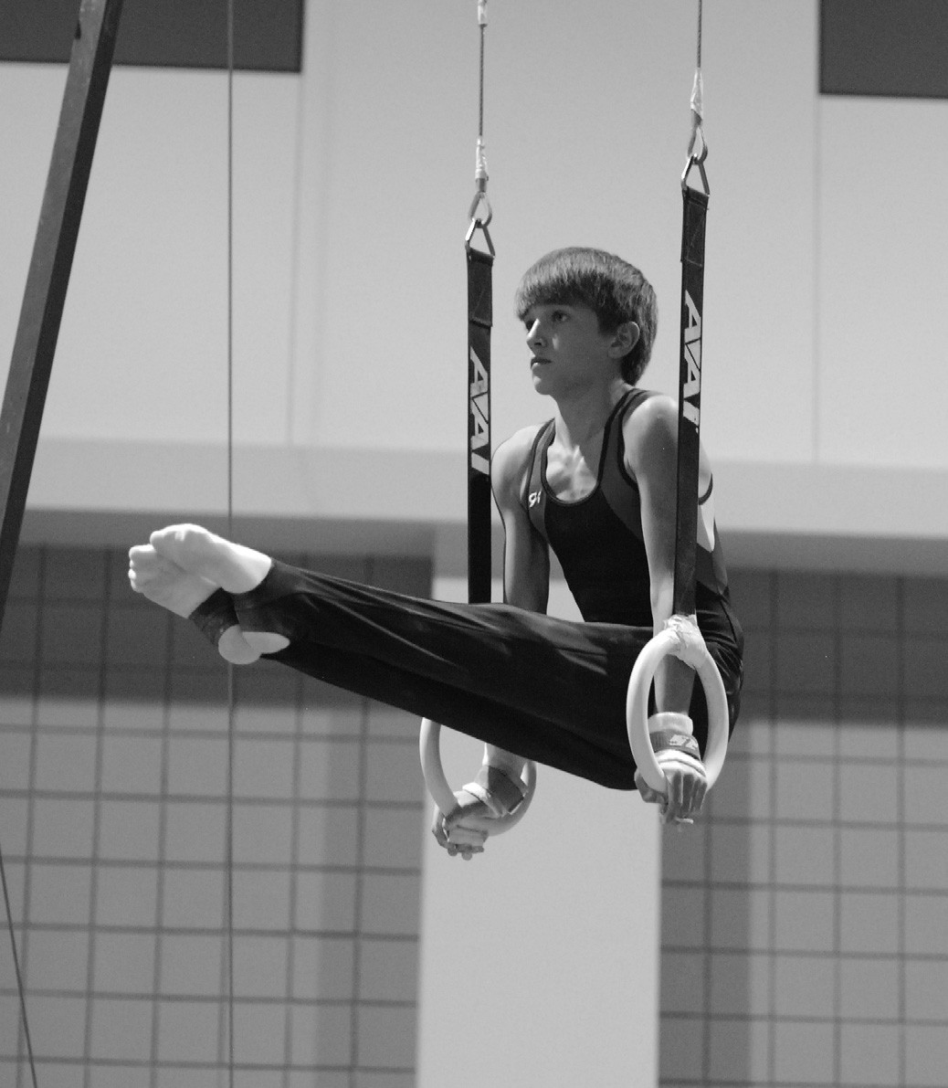 Zachary Beason, 12, won a bronze medal at the Region 8 Men's Gymnastics Championships in Raleigh, N.C., on April 14. He finished third overall in a field of 54 Level 7 boys competing in his group. All had qualified as top competitors from individual state championships in seven southern states: Alabama, North Carolina, South Carolina, Florida, Georgia, Mississippi, and Tennessee. Beason finished sixth on high bar, third on floor exercise, third on pommel horse, second on steel rings, and third overall. He is the Alabama state champion for 2012, and was also state champion last year competing at Level 6. He is the son of Randy and Debra Beason, owners of Neely Arts Center in Oneonta, who say Zach works very hard 'even when the coach is not looking.' Sign of a true competitor – it's become part of his character. Zachary has been involved in gymnastics for only three years, a real short-timer in a sport where many start at age 5 or 6. – Ron Gholson
