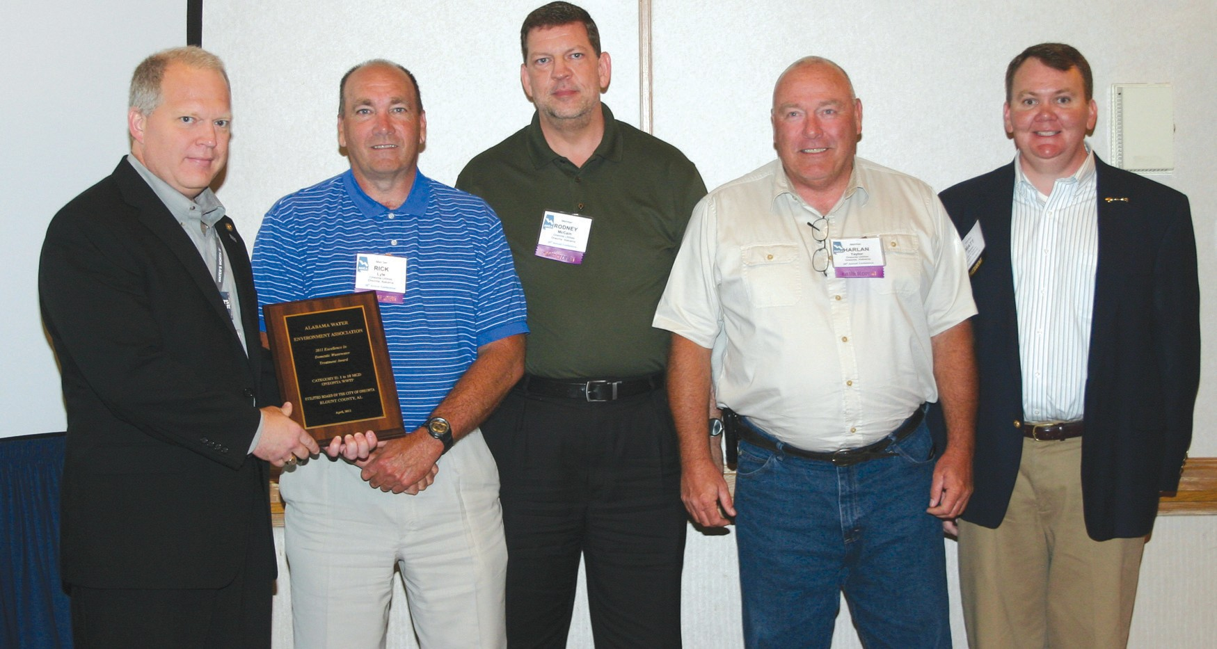 Three Oneonta Utilities employees pose with Alabama Water Environment Association executives as they celebrate awards for outstanding performance at the association's annual conference on April 16. From left, Scott Cummings, Water Environment Foundation member; Rick Lyle, Oneonta wastewater superintendent, holding his Operator of the Year individual award; Rodney McCain, Oneonta Utilities general manager; Harlan Taylor, Oneonta wastewater operator; and Matt Dunn, Alabama Water Environment Association president.