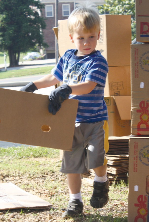 Henry Lanier, age 4, was one of the youngest volunteers at the potato drop.