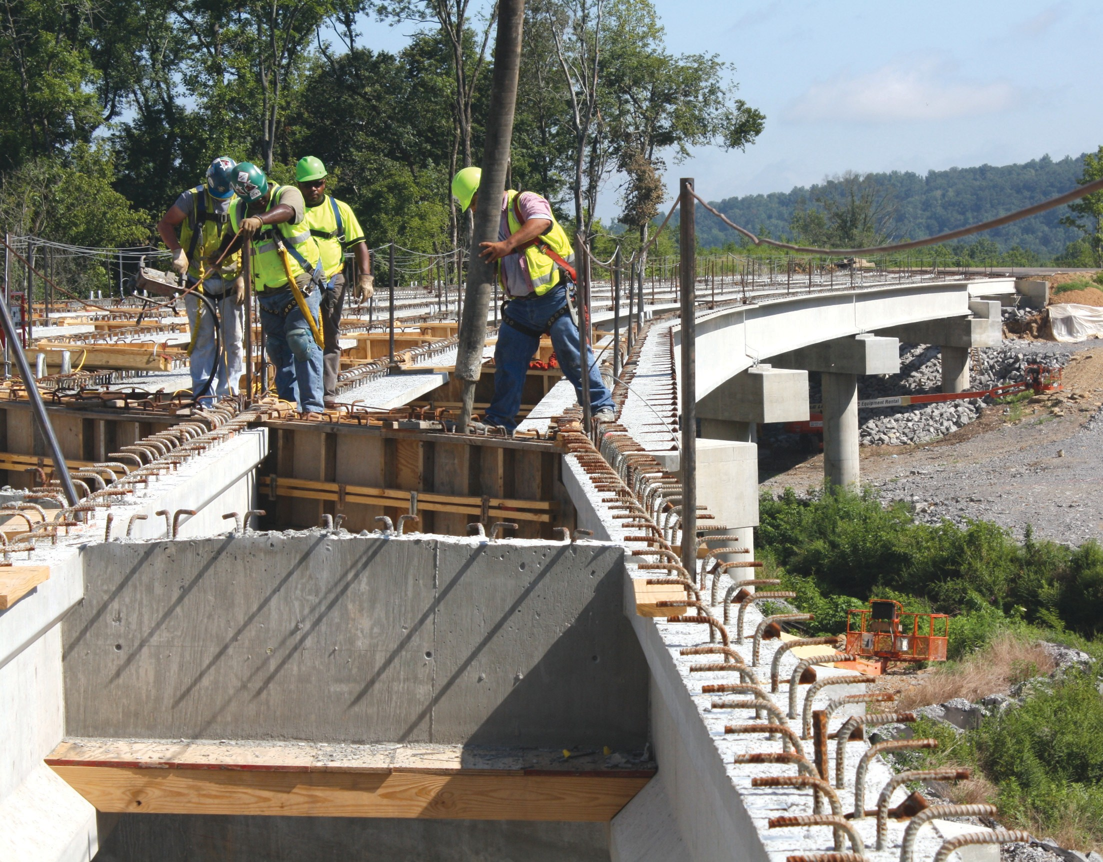 Construction workers with ReCon Inc. pour cement for the new bridge on Ala 75.