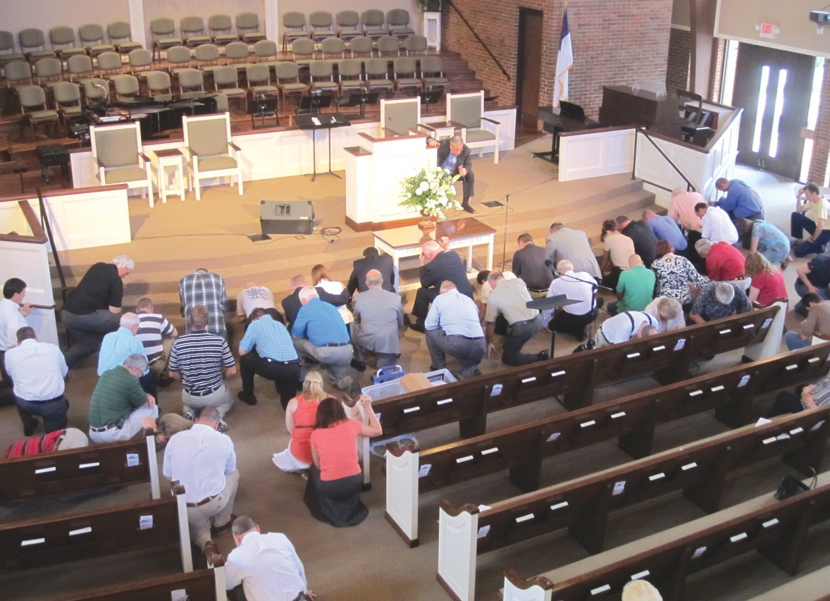 Anti-alcohol meeting Sunday at Oneonta First Baptist Church begins with an altar call communal prayer, led by pastor Larry Gipson, as the group prepares for a talk by Joe Godfrey, executive director of the Alabama Citizens Action Program (ALCAP). More than 100 attended the meeting.