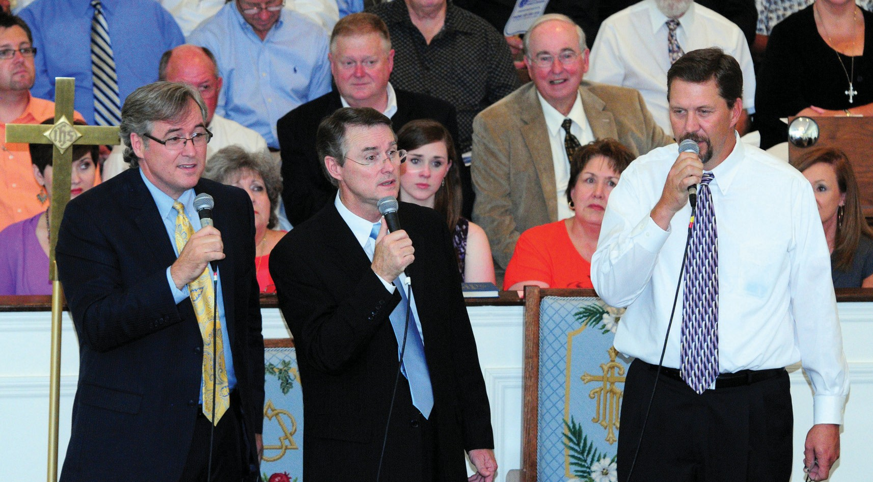 The musical Green Brothers (from left) Mark (lead and piano), Chris (tenor and baritone), and Benny (bass), team up on an a capella performance of a childhood favorite Is That the Lights of Home? at the annual Blount County Gospel Choir concert Sunday. Gazing on in rapt approval two rows back in the choir is the patriarch himself, Frank Green, former Blount County Probate Judge and father of the entire trio. Also visible just over Benny's shoulder in the first row is Chris's wife Pam who does more of the work than she gets credit for in staging the annual event. The 50-odd voice choir, with members representing more than 20 churches, gave its seventh annual performance at the event hosted since its outset by Lester Memorial United Methodist Church. People keep coming. – Ron Gholson