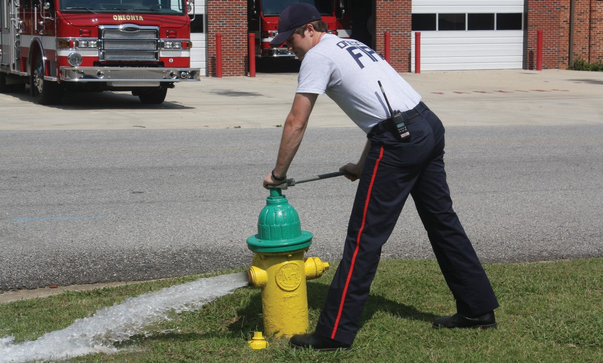 Andrew Gargus, an Oneonta firefighter for three years, demonstrates hydrotesting.