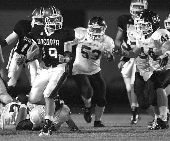 Oneonta running back Tyler Smith is pursued by Susan Moore's Cody Jones (53) and Chase Brown (44).
