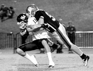 Oneonta's Blake Bean sacks Susan Moore quarterback Ryan Brown.