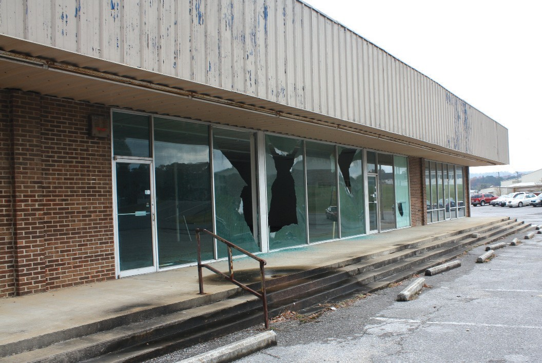 The old Bargain Town building's windows were shot out last week. The Oneonta Police Department is investigating the incident.