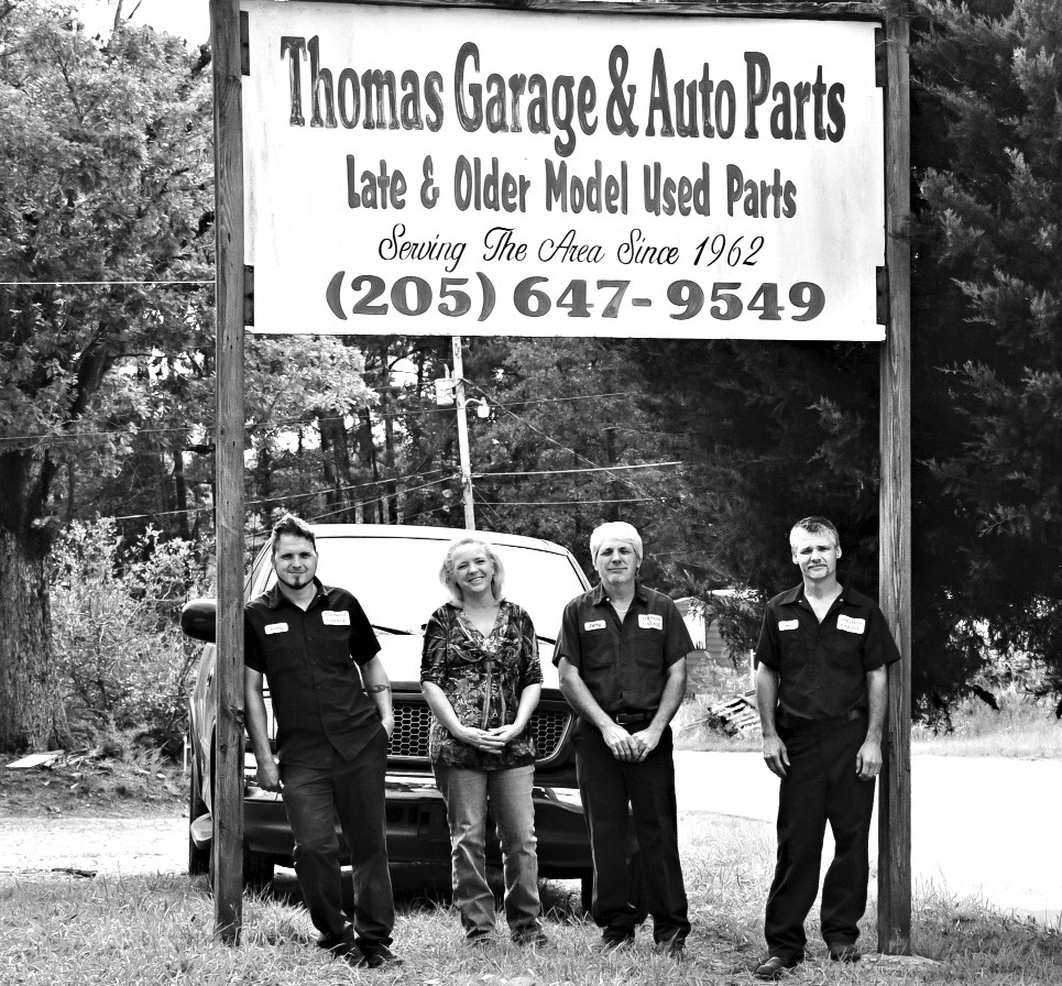 Jeremy Hopkins, Brenda Thomas, Johnny Thomas, and Joseph Thomas own and operate Thomas Garage. This year, the business is celebrating its 50-year anniversary.