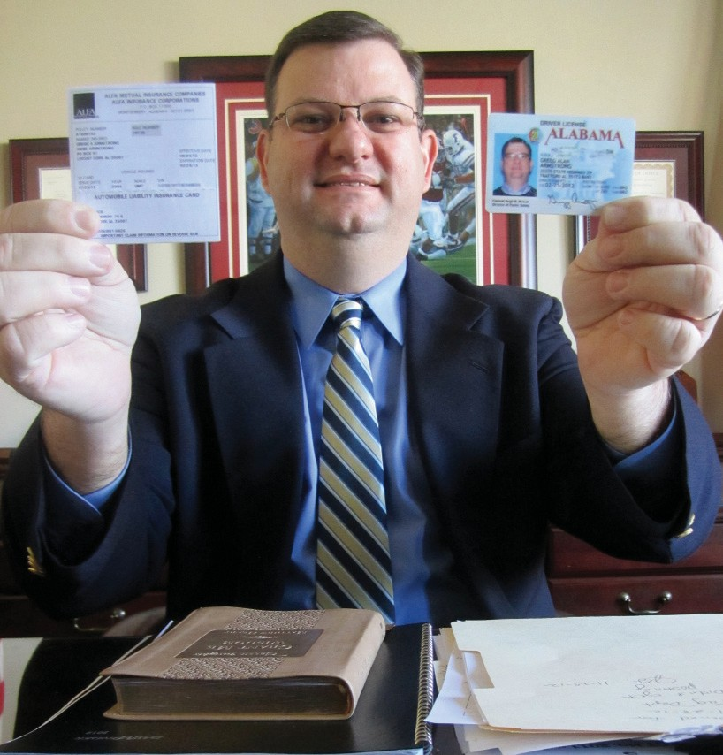Revenue Commissioner Gregg Armstrong displays the two cards vehicle owners need to bring to the courthouse when applying for a license or renewing registration on their vehicles: an up-to-date proof of insurance card and valid Alabama driver's license.