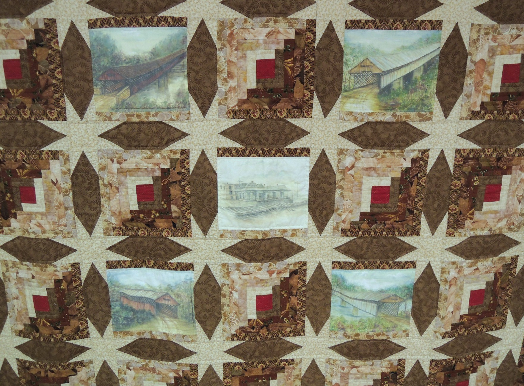 The Log Cabin Star quilt features the paintings of Helen Brown.