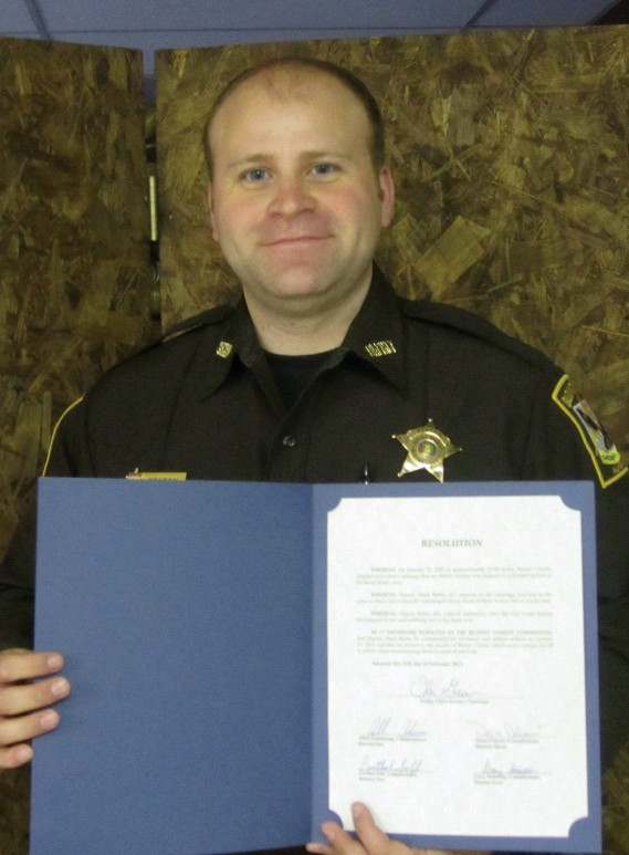 """Deputy Mark Staton was commended at the commission meeting Monday for his """"heroic and selfless actions"""" on Jan. 15 when he rescued an elderly woman trapped in her flooded vehicle on Ricetown Road. Staton waded across some 100 yards of waist-deep water to the stranded vehicle and carried the woman to safety. His actions should """"stand as an example for all to follow when encountering those in need,"""" the commendation read."""