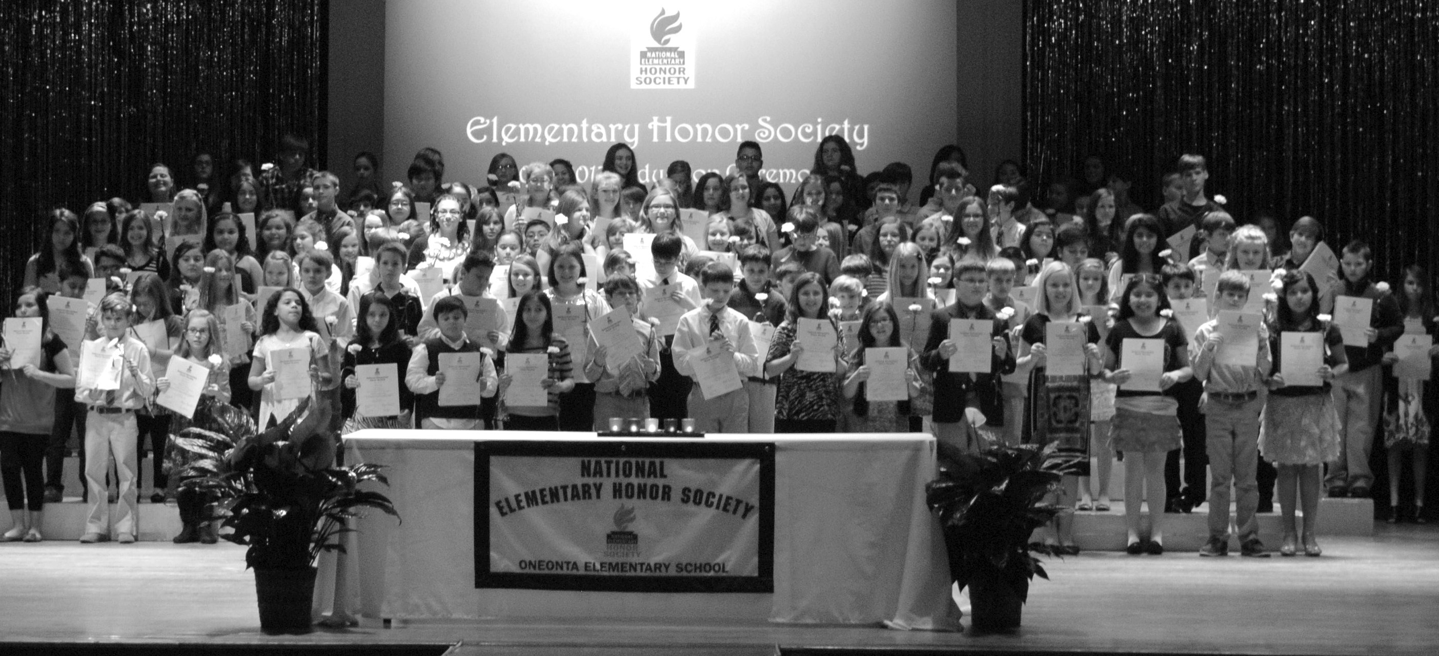 Oneonta Elementary hosted its inaugural National Honor Society ceremony on Monday in Eris Horton Auditorium. One hundred and thirty one students in grades 4 - 6 were inducted into the society. Students were chosen based on their performance in scholarship, service, leadership, character, and citizenship. Each inductee was presented with a yellow carnation and a certificate after being tapped by a National Honor Society member from Oneonta High School. Guest speaker Matt Scott of Oneonta First Baptist talked about character before the students were dismissed to attend a reception for the inductees and their families. – Nicole Singleton