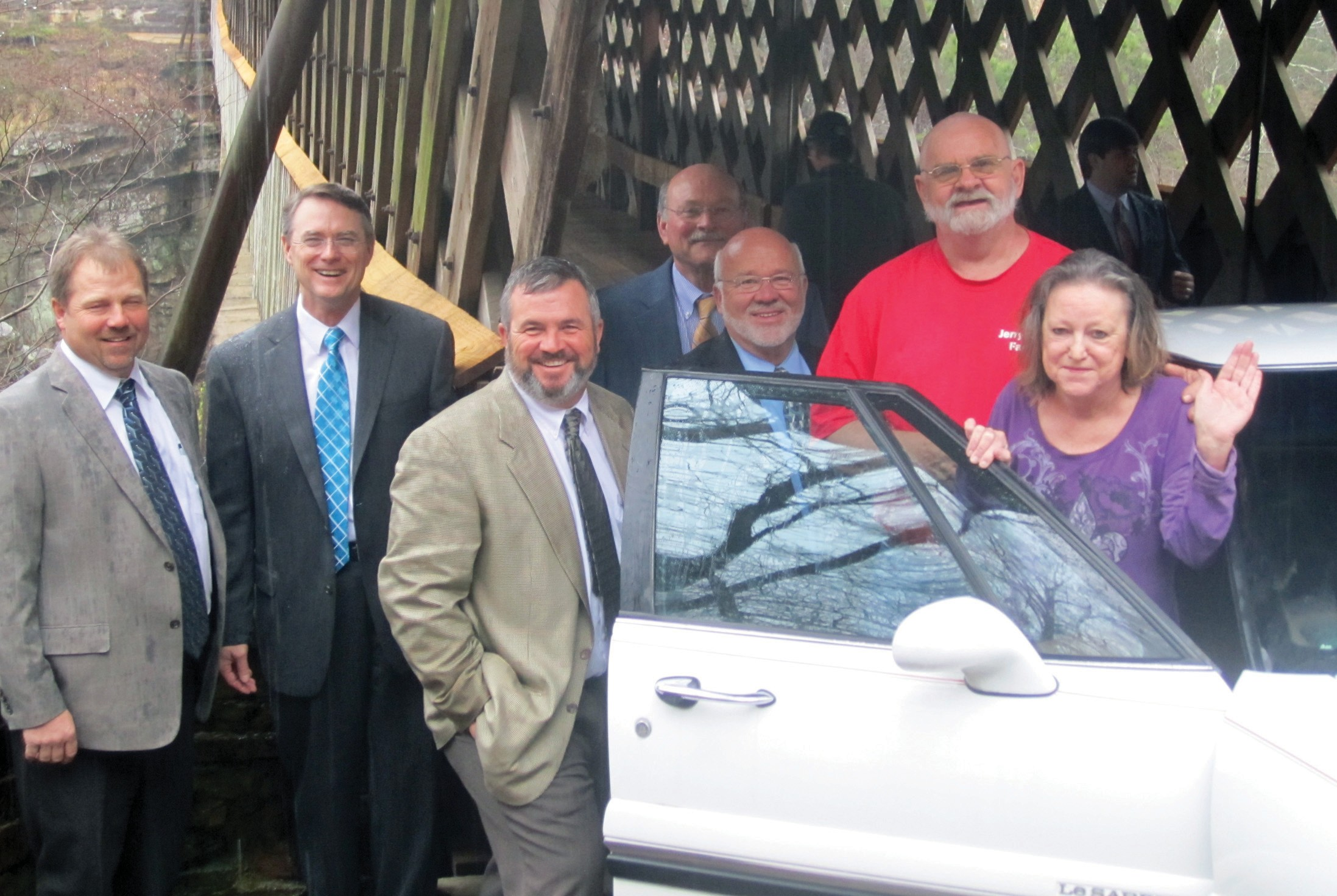 The county commission Monday removed barricades at Horton Mill Covered bridge, opening it to vehicles for the first time since 2009 and signaling the completion of a nearly four-year process of renovating the county's three signature covered bridges. From left, Commissioner Dean Calvert, Probate Judge/Commission Chairman Chris Green, Commissioner Allen Armstrong, Commissioner Carthal Self, Commissioner Gary Stricklin, and Jerry and Jean Gibbs, first citizens to cross the bridge (in a 1999 Buick LeSabre) after barricades were removed. Mrs. Gibbs's parents, Bertha and William Claude Murphree Sr., were the first to cross the bridge at its original opening in 1932. The drove across in a wagon, their mode of transportation at the time. – Ron Gholson