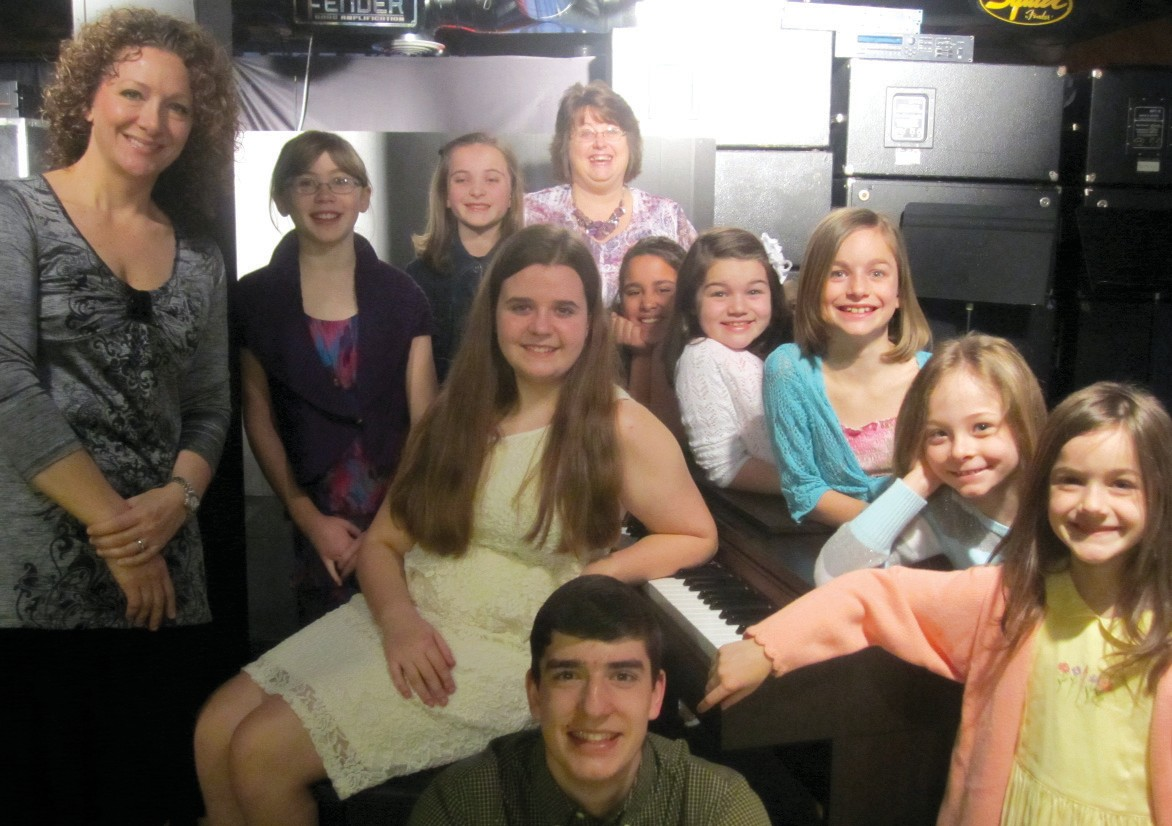 Students from Neely Arts Center will play before judges at the Alabama Music Teachers Association audition on April 13 at Snead State Community College. Clockwise from left, (not counting teachers): Annie Grisham (seated), Jessi King (in black sweater), Breanna Smith, Olivia Carroll, Audrey Fuller, Jessica Beason, Lillian Staton, Hope Beason, and Daniel Young. Ella Cleveland was not present. Instructors are Deborah Beason, left, and Anne Casey, back center.