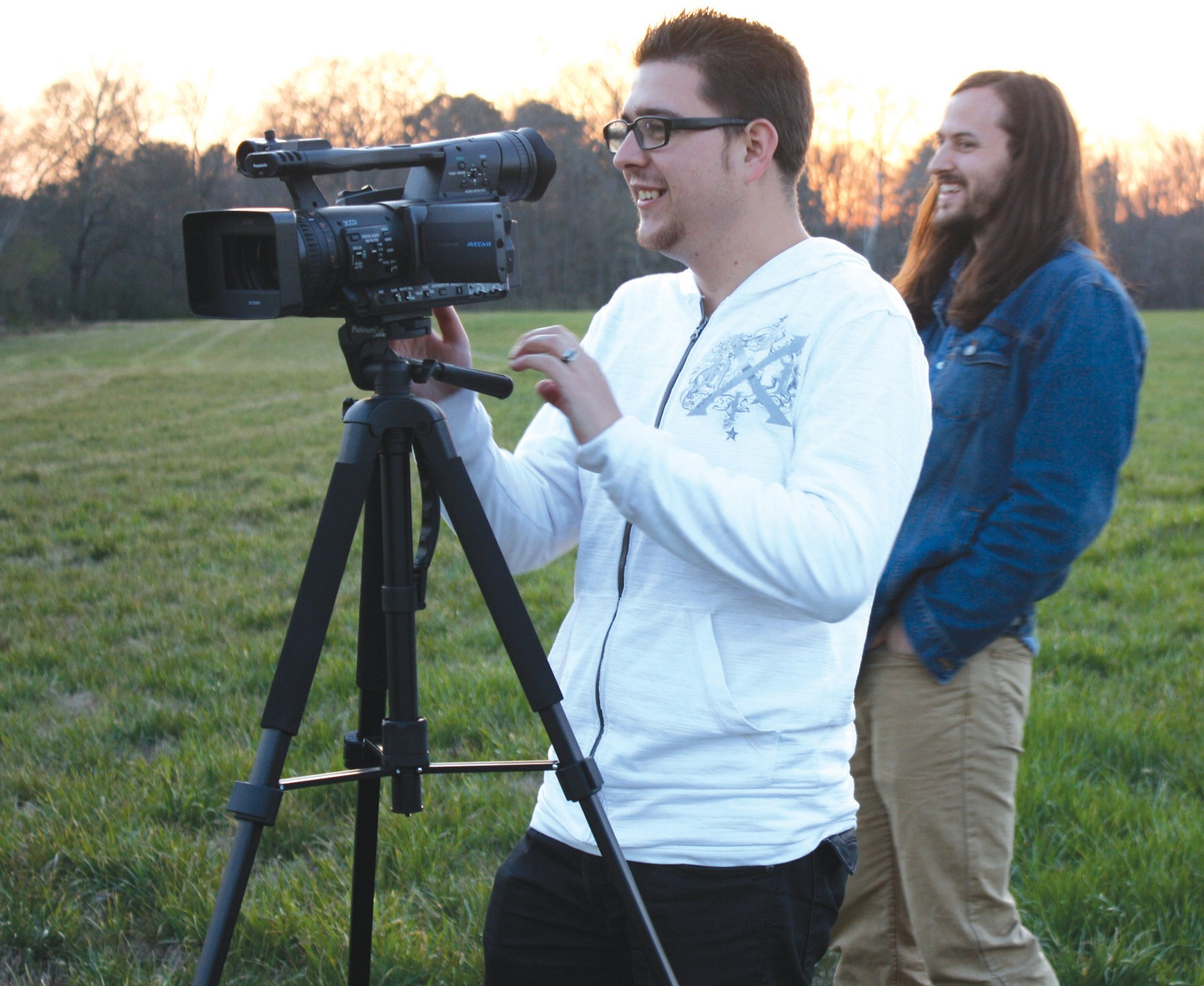 """Director Scott Duarte films a scene for his film """"Project Urban Legend,"""" along with his friend, Stuart Sanders, who is not only in the film, but also welcomed Duarte to film on his family's property in Oneonta."""