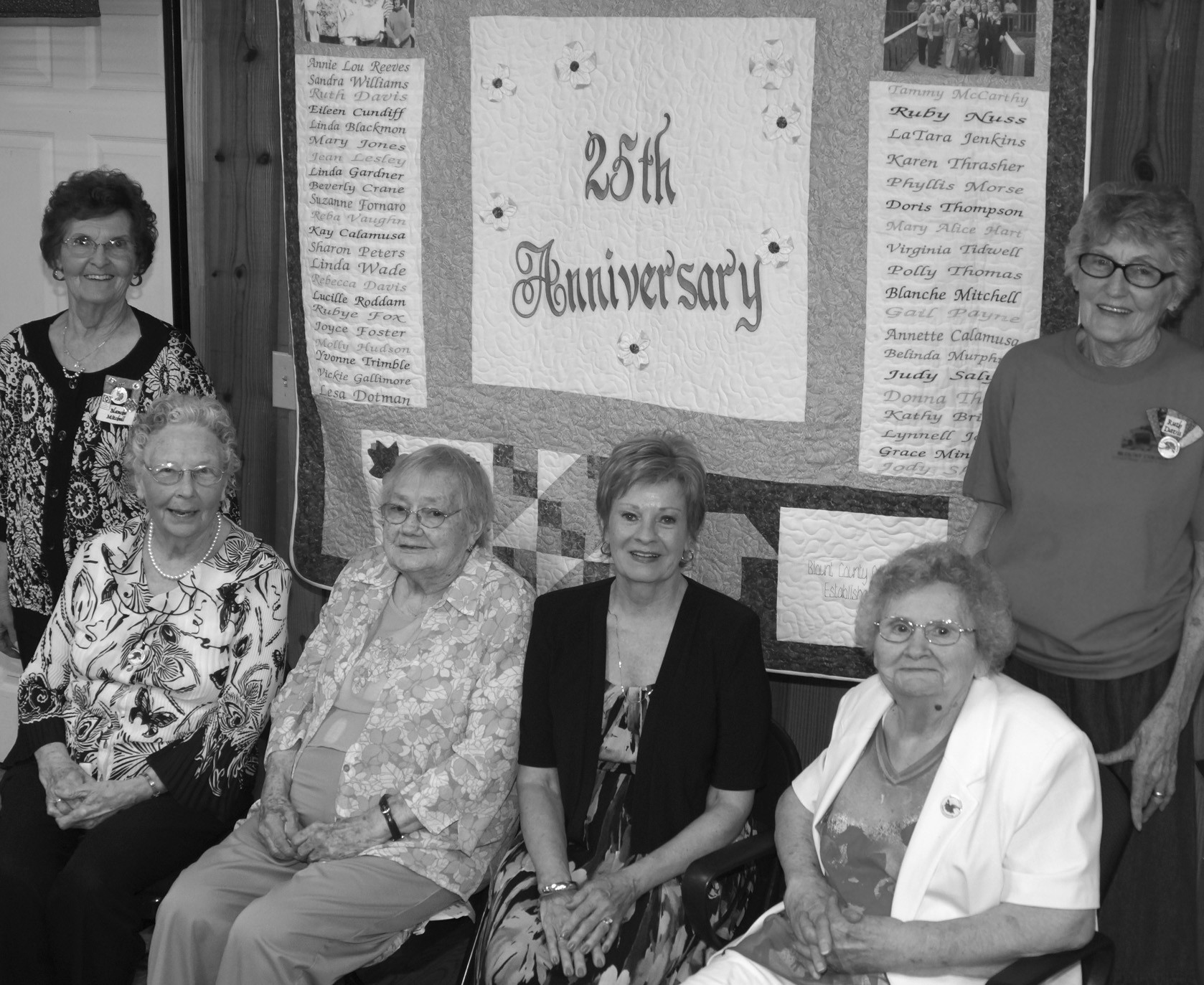 Sustaining members honored at the Blount County Quilters Guild June 4 anniversary celebration are (from the left) Blanche Mitchell (standing),Virginia Tidwell, Lucille Roddam, Carol Reid, and Annie Lou Reeves (standing). JoAnne Pruett was not present for the photo. The quilt shown was quilted by Guild members and dedicated to the seven sustaining members. They were also given quilted tote bags handmade by Guild members. Sustaining members are long-term members who have been affiliated with the Guild since its beginning or since its earliest years. The quilt features names of all currrent Guild members and seven quilt blocks sewn by or for the honorees. It was designed, pieced, and quilted by Guild members. Those interested in quilting are invited to visit the Guild which meets on Tuesdays and Thursdays, 10 a.m. to 2 p.m., and on the second and fourth Saturdays at the same time at the Quilters Cottage in Palisades Park. For further information about the Quilters Guild and its activities, call Phyllis Morse at 205-994-4749. – Ron Gholson