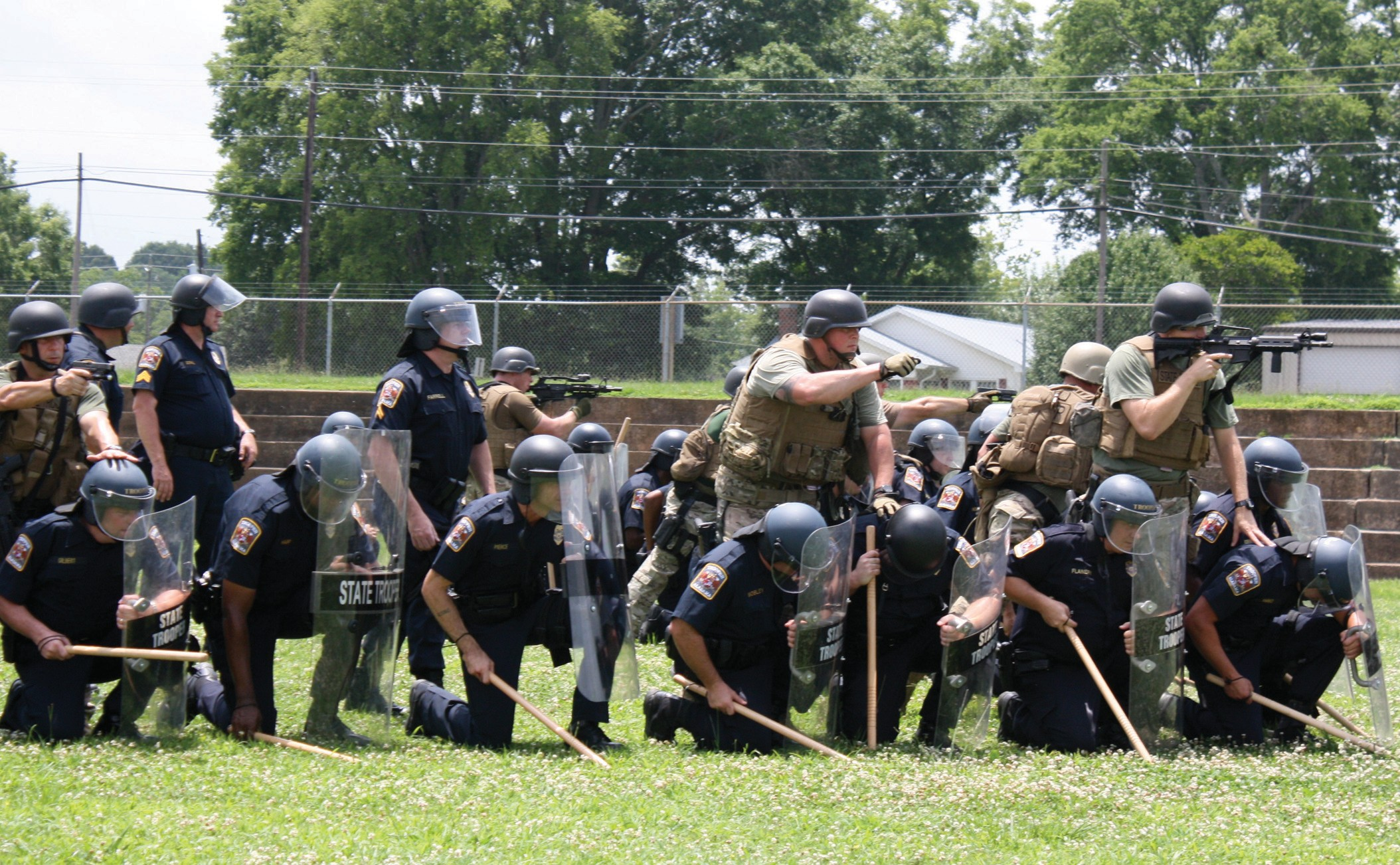 On Thursday, June 27, approximately 100 state troopers from the north and north central platoons conducted their annual crowd control training at the Blount County-Oneonta Agri-Business Center. According to Lt. Allan Battles of the Alabama Department Highway Patrol, the two platoons involved in the training stay current on what to do if crowd control is needed. Most recently, the troopers have been more involved in situations like tornado and hurricane disaster relief. After these types of situations occur, the platoons assist in closing roads, directing traffic, unloading trucks, providing security, and other activities during and after the disaster. Battles says this is the first time he can remember the crowd control formation training being conducted in Oneonta, but he said it was a good choice because of its central location. Troopers traveled from as far away as Tuscaloosa, Gadsden, and Talladega. – Nicole Singleton