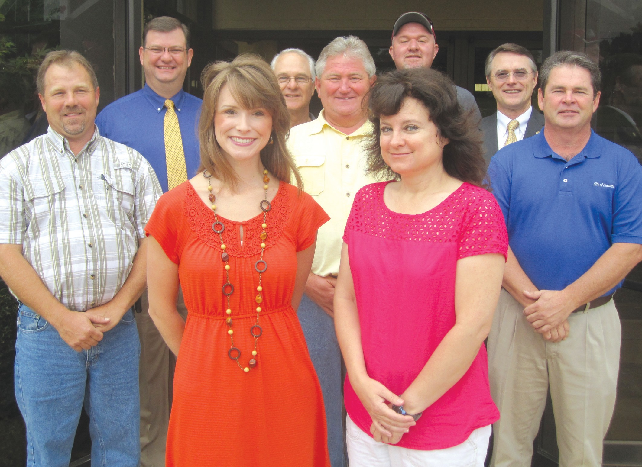 The problem solvers. (front row, from left) county fair coordinators Kelly Doty and Joan Epps; (back row, from left) District 3 Commissioner Dean Calvert, Revenue Commissioner Gregg Armstrong, Oneonta Mayor Ross Norris, Agri-Business Board chairman Jeff Hallmark, Oneonta public works director Rodney Wall, Probate Judge/Commission Chairman Chris Green, and Oneonta city manager Ed Lowe.