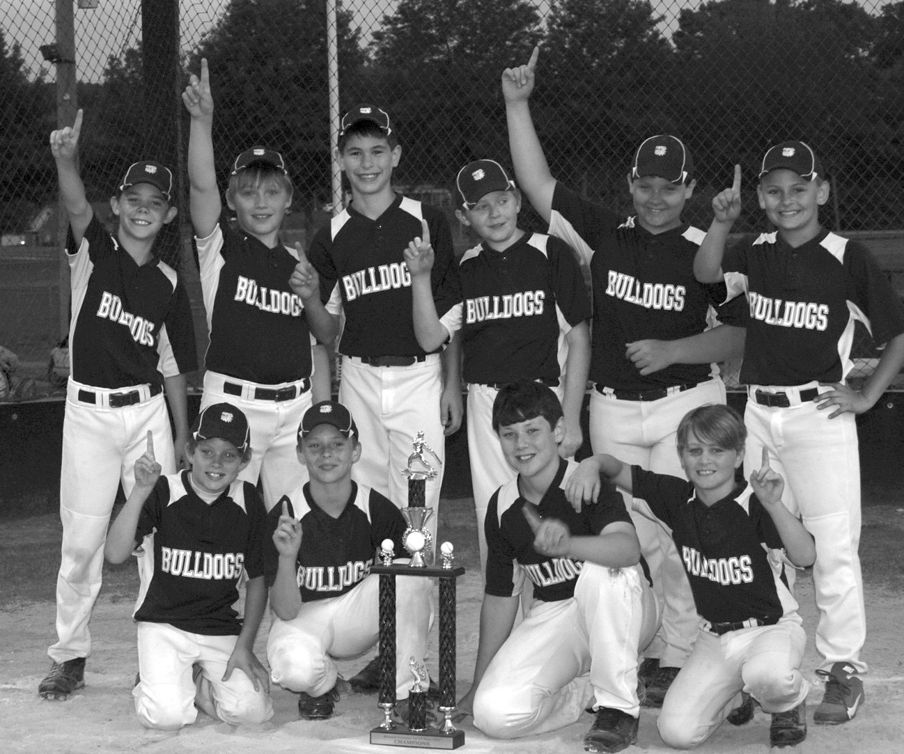 The Snead Bulldogs are the Blount County 12-andunder champions for the third year in a row. Pictured are, front row (left to right), Kevin Thomas, Matt Clowdus, Gavin Harper, and Camden Lackey. Back row, (l to r), John David Hutchens, Micheal Moseley, Adam Vitolo, Will Hutchens, Steven Thomas, and Andrew Shelton. Not pictured are coaches Kevin Shelton, Jason Lackey, Brant Hutchens, and Michelle Shelton