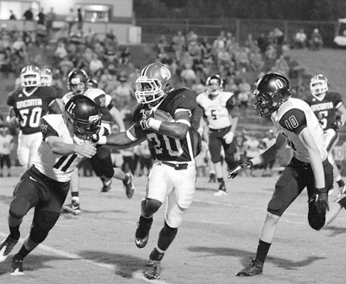 Terrell McDaniel pulls away from a pair of Crossville defenders.