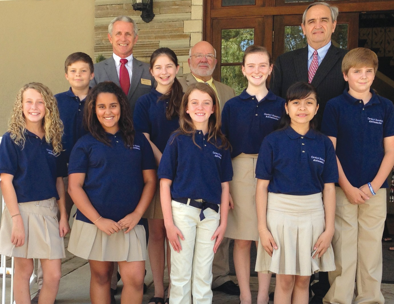 Featured at the last luncheon were eight sixth-graders who are members of the Cleveland Elementary Ambassadors. Front row (from left): Kiley Adams, Olivia Carrol, Karli Ann Wilson, and Mary Contreras. Second row (from left): Elijah Longshore, Jenna Friese, Madison Love, and Matt Lee. Back row (from left): chamber executive director Donny Ray, District 3 Commissioner Gary Stricklin, and Blount County Supt. Jim Carr.