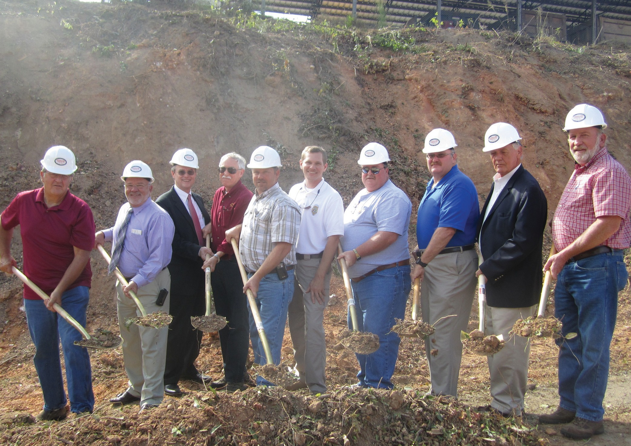 Shown from the left are 911 board member Bob Sanford, District 4 Commissioner Gary Stricklin, Commission Chairman Chris Green, 911 director and board member Max Armstrong, District 3 Commissioner Dean Calvert, board members Brandon Horton, Steve Pass, Tim Kent, Arrington, and Dean Gilbert.