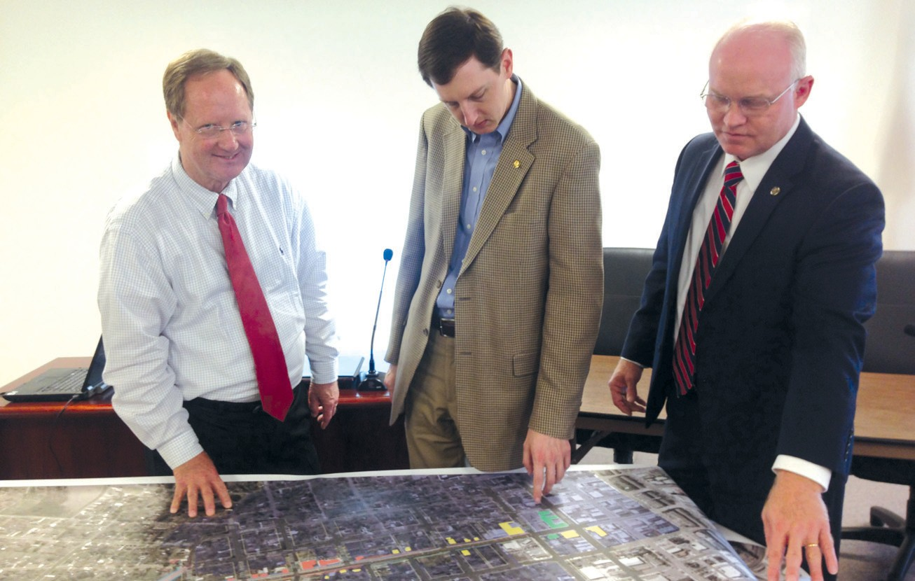Members of Blount County's legislative delegation (from left), Rep. Randall Shedd, Sen. Clay Scofield, and Rep. David Standridge, confer over a map showing the route of U.S. 278 across Cullman and Blount counties.