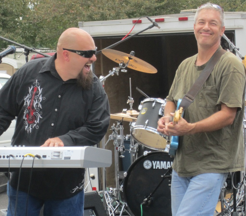 From left, Jeremy Lesley and Randy Beason of the Jeremy Lesley Band, a staple of the Covered Bridge Festival, epitomize the spirit and sense of fun of the annual fall classic, now in its 30th year.