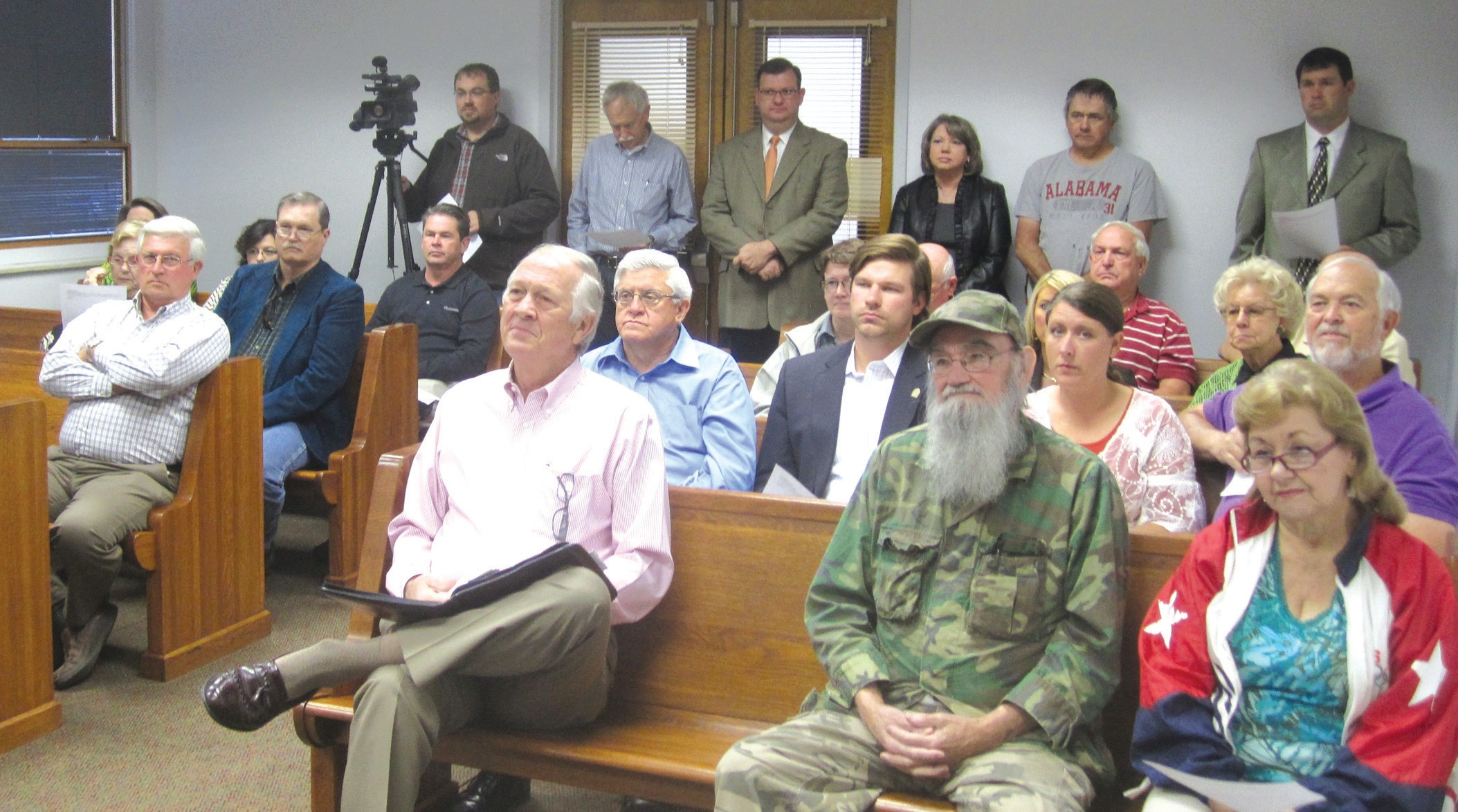 FULL HOUSE. Monday's commission business meeting turned out a rare standingroom only crowd for the resolution of a postponed decision on funding for what came to be seen as dueling chambers of commerce.