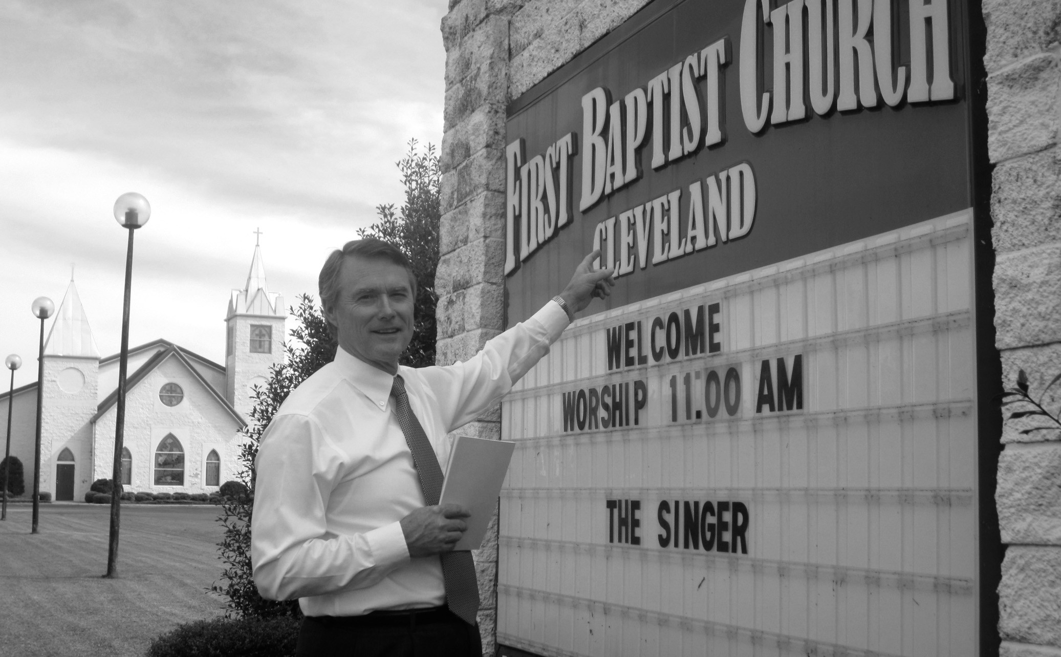 """Chris Green, minister of music at Cleveland First Baptist Church, emphasizes the venue for an upcoming singing school that he, pastor Rick Dill, and the congregation are hosting at the church. The school, modeled loosely on similar schools of half a century ago, is designed to help people learn to sing harmony, or """"parts"""" that are a distinguishing feature of much if not most of southern gospel music over the last 150 years. That skill is dying out as choir members who learned to sing in schools of yesteryear retire and are not replaced by members of equivalent training. The singing school hopes to help remedy that by providing an opportunity for people to learn a new interest and skill to enrich their lives. Green holds a copy of the songbook Miracles, compiled by Charles Towler, instructor for the school. The entire community is invited to attend. Times are Sunday, Nov. 3, 3 p.m. to 7 p.m. and Monday – Thursday evenings, Nov. 4-7, 6:30 p.m. to 8:30 p.m. Call (205) 429-3210 for more information or to indicate your interest. Also, cgreen@otelco.net, to request a space. School is free; an offering will be taken to cover expenses. – Ron Gholson"""