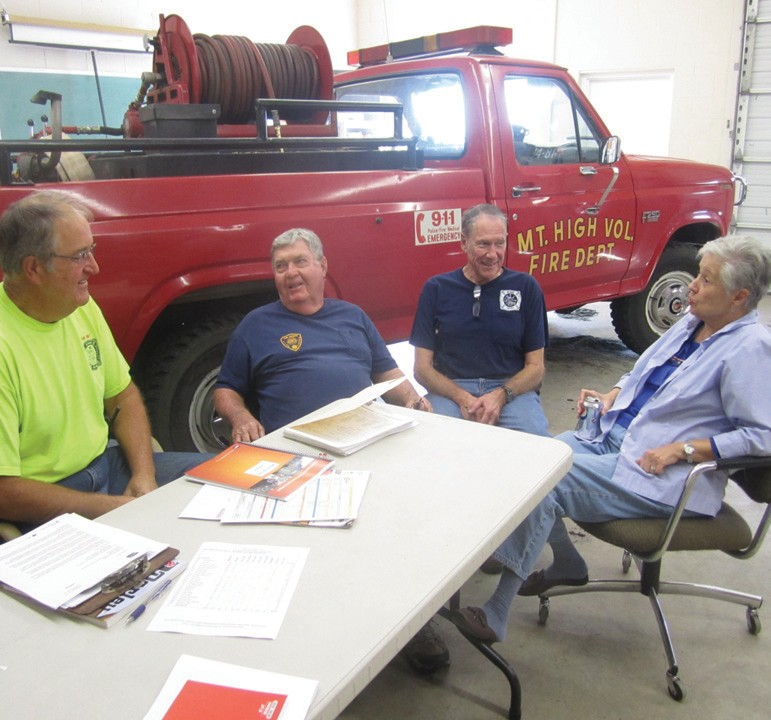 Mt. High Volunteer Fire Department mainstays (from left), Chief Bob Sanford, Larry Russell, Ron Lowe, and Janice Russell discuss challenges of keeping an important community service functioning with dwindling manpower.