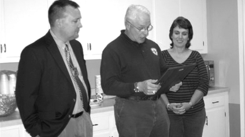 (From left) Department of Human Resources (DHR) quality assurance supervisor Robert Burrow, Oneonta Mayor Ross Norris, and DHR program supervisor Cheryl Helton share a celebratory moment as the mayor reads a resolution passed by the city council recognizing Nov. 23 as National Adoption Day. Members of the local DHR organization, along with board members, adoptive families and children celebrated the event at the DHR office on Nov. 13. The event also acknowledged the 12 children adopted in Blount County since January 2013. National Adoption Day is a way to raise awareness of the more than 100,000 children in foster care in the U.S. who are waiting to be adopted. Singled out for special thanks are Shirley's Fine Jewelry in Oneonta, White Jewelry in Cullman, and Carla Wilson of Alabama Post- Adoption Connections for their contributions to adoption gifts for children. For more information, visit www.nationaladoptionday.org. – Ron Gholson