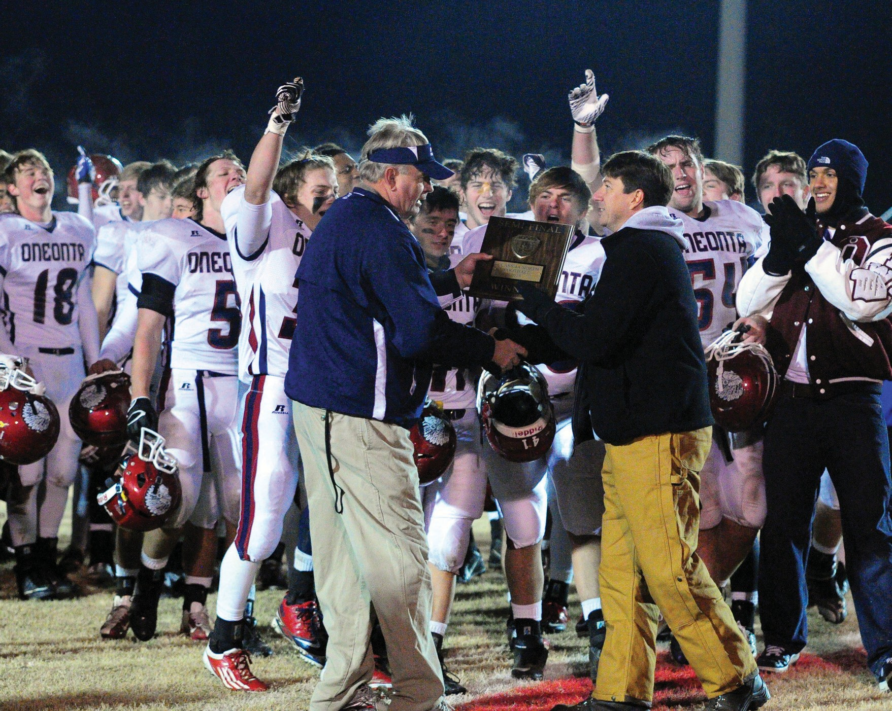 Oneonta head coach Don Jacobs accepts the North Division trophy after last Friday's 35-21 victory over Munford. The Redskins will play Charles Henderson of Troy for the 4A title Friday morning at 11 o'clock at Bryant-Denny Stadium in Tuscaloosa. This is the third straight year that the Redskins have made it to the championship game. For a recap of last week's game and a preview of the title game, see SPORTS A4.