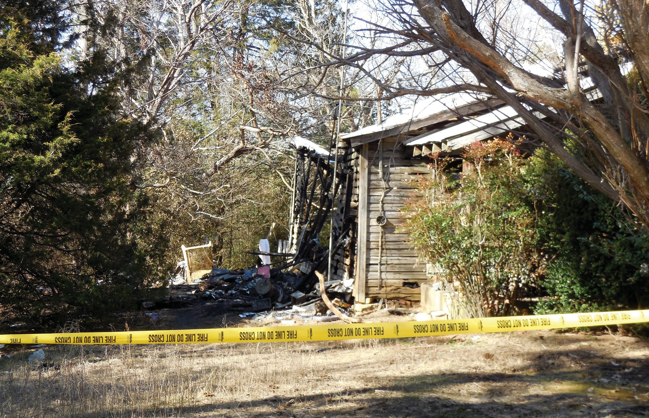 A body was found in this burned-out house on Ebell Road.