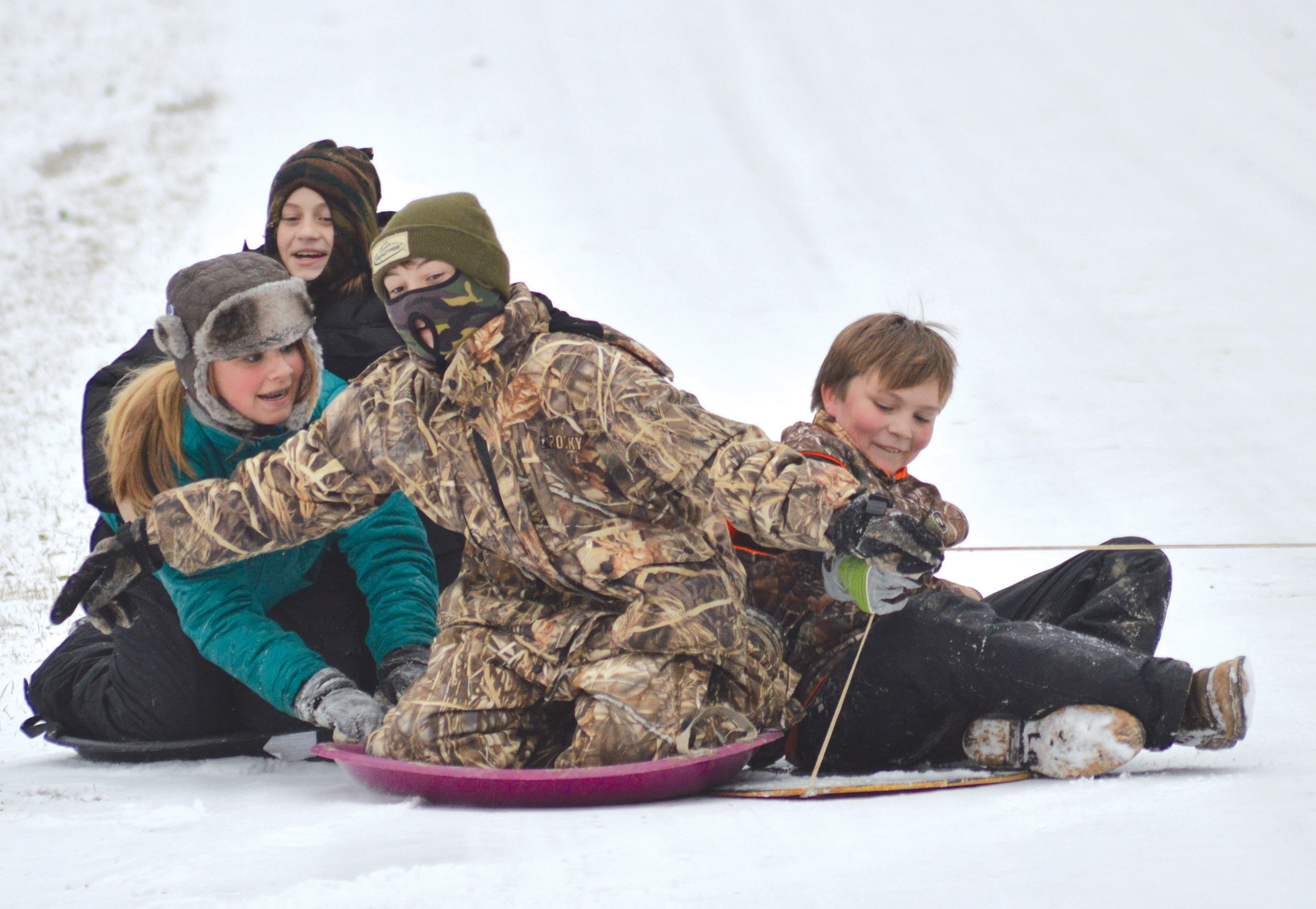 Susan Moore students Lyndsey Nolen, 13, Claire Perkins, 10, Drew Williams, 12, and Tanner Nolen, 11, enjoyed an afternoon of sledding last Tuesday. – Nicole Singleton