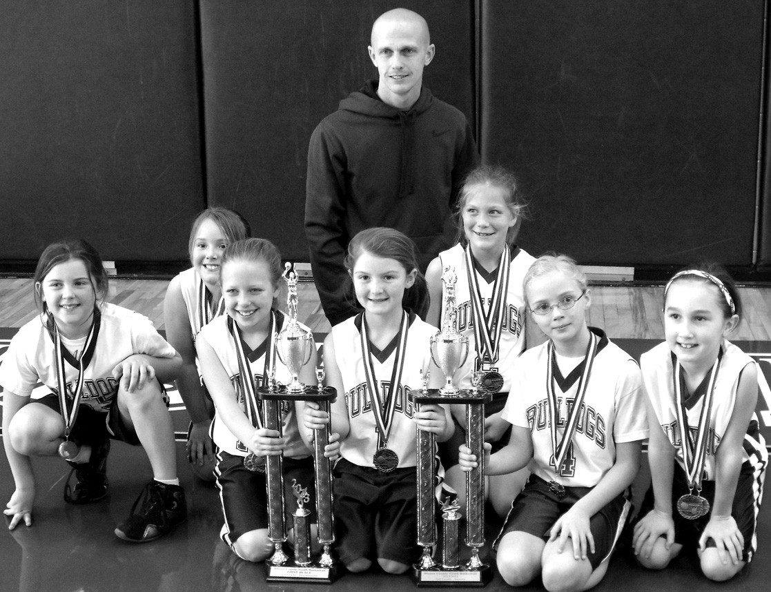 The Susan Moore thirdgrade girls won the regular season and tournament titles this year in the Blount County Youth League. The team finished undefeated (11-0) for the second year in a row. Pictured are (left to right) Abby Burgess, Anna Brown, Kaitlyn Hill, Kadence Standridge, Lacey Floyd, Ally McBrayer, Marisa Bryan, and coach Keith Bryan.