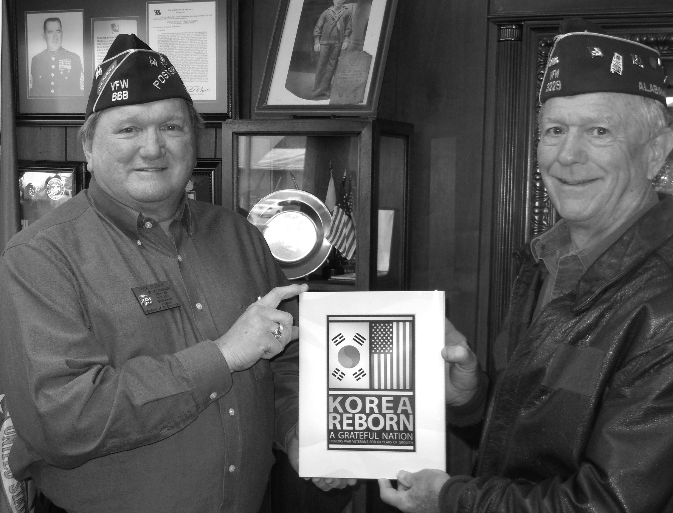 Jack McNair, (left) senior vice commander of Kelly Ingram Post 668, and Frank Waid, commander of Springville VFW 3229, delivered books chronologically recapping the Korean War to the Blount County Museum earlier this month. Books are available at the Blount County Memorial Museum free to veterans. 'Korea Reborn: A Grateful Nation Honors War Veterans for 60 years of Growth,' was made by the South Korean government as a gift for veterans, and anyone interested in obtaining one can contact Amy Rhudy, Blount County Memorial Museum curator. The books will be available for pick up on March 28 from 10 a.m. until 2 p.m. Local VFWs will also be able to receive the books, according to McNair. 'Many Alabama veterans have looked through the pictures in this book and found pictures of themselves or pictures of places they knew,' McNair said. For more information, call Rhudy at 625-6905. – Nicole Singleton