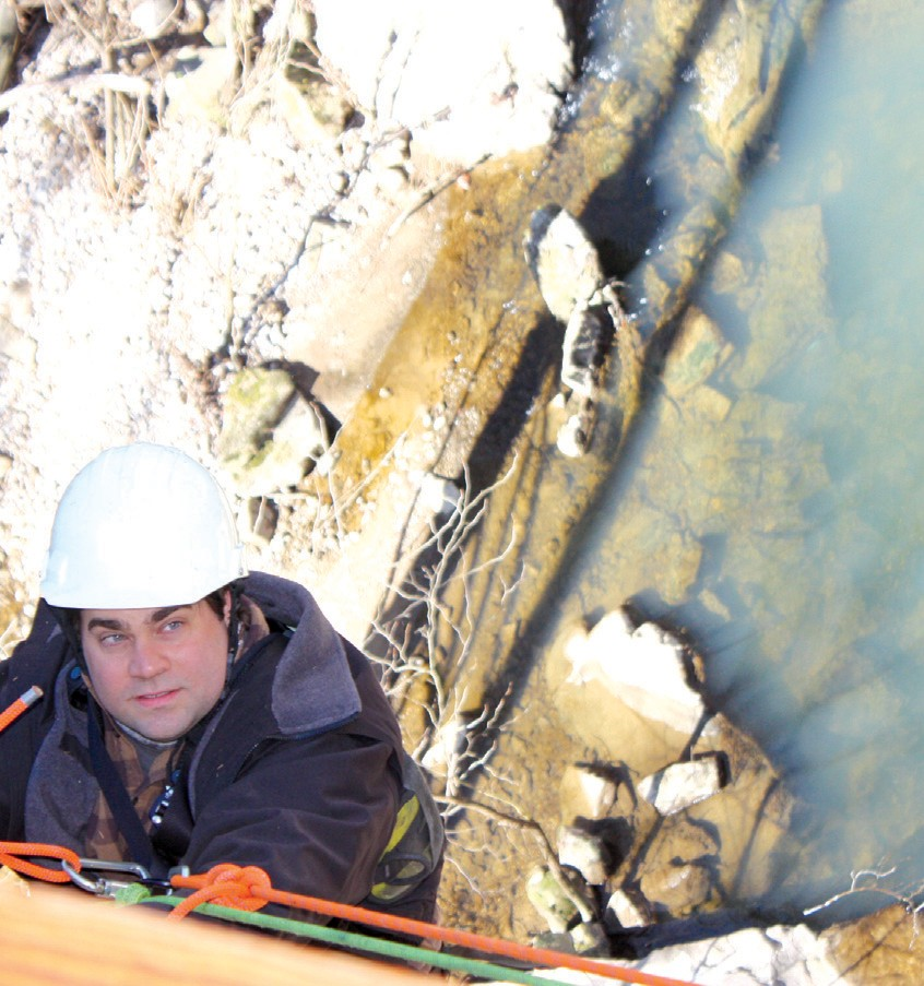 During the Horton Mill Covered Bridge inspection, Sitton dangles 75 feet above water.