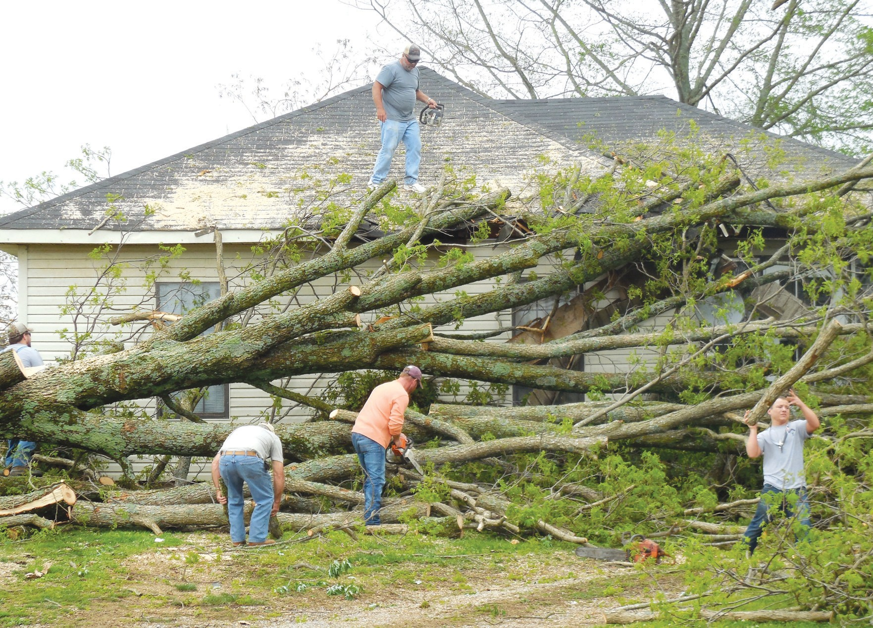 Multiple houses on Airport Road, including this one, were damaged during the Tuesday morning storms. Officials, volunteers, and family members of those affected assisted in the clean up throughout the day Tuesday.
