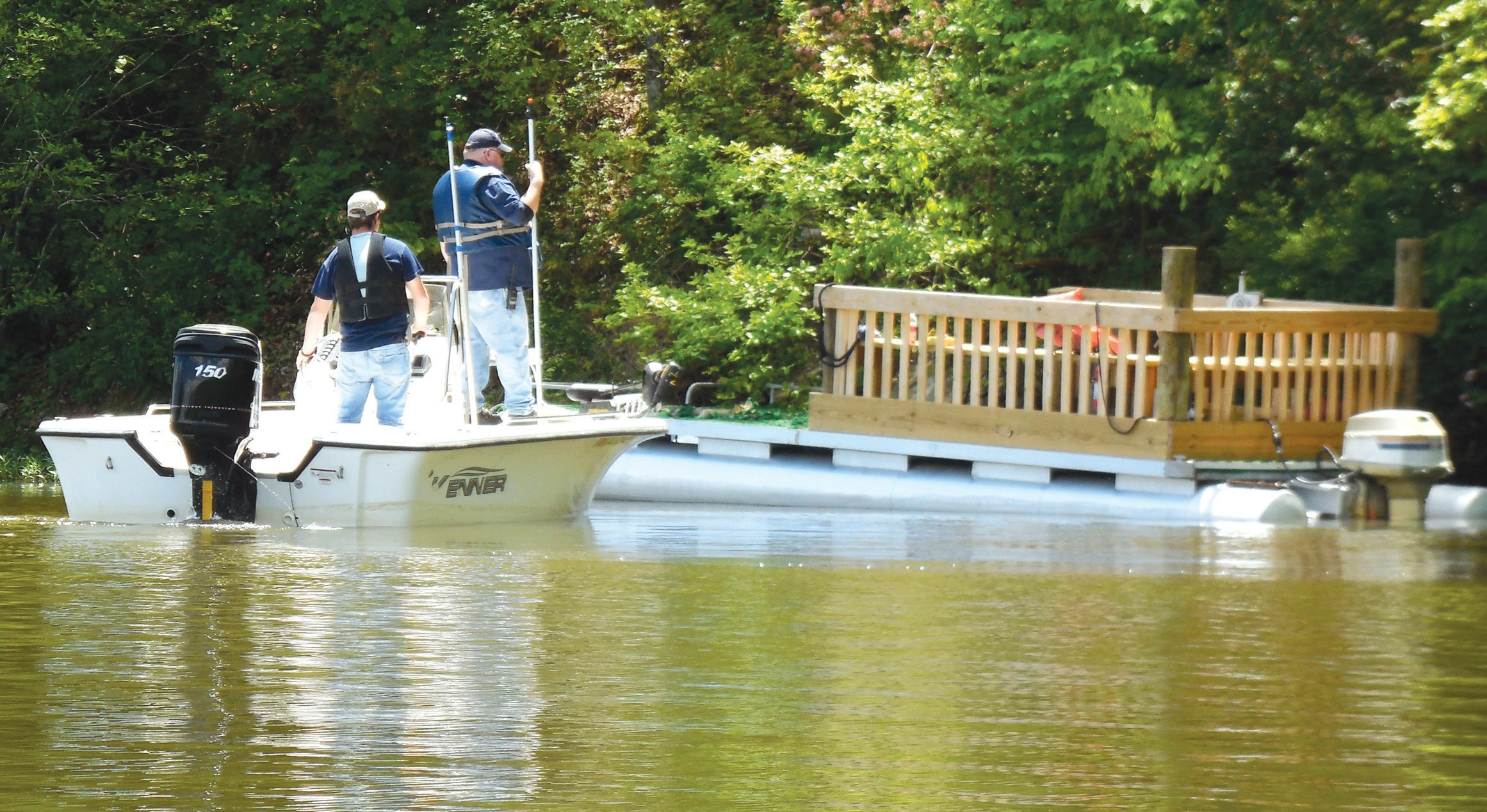 Straight Mountain Volunteer Fire Chief Charles Tipton surveys the boat the teenager was on when he fell into the water.