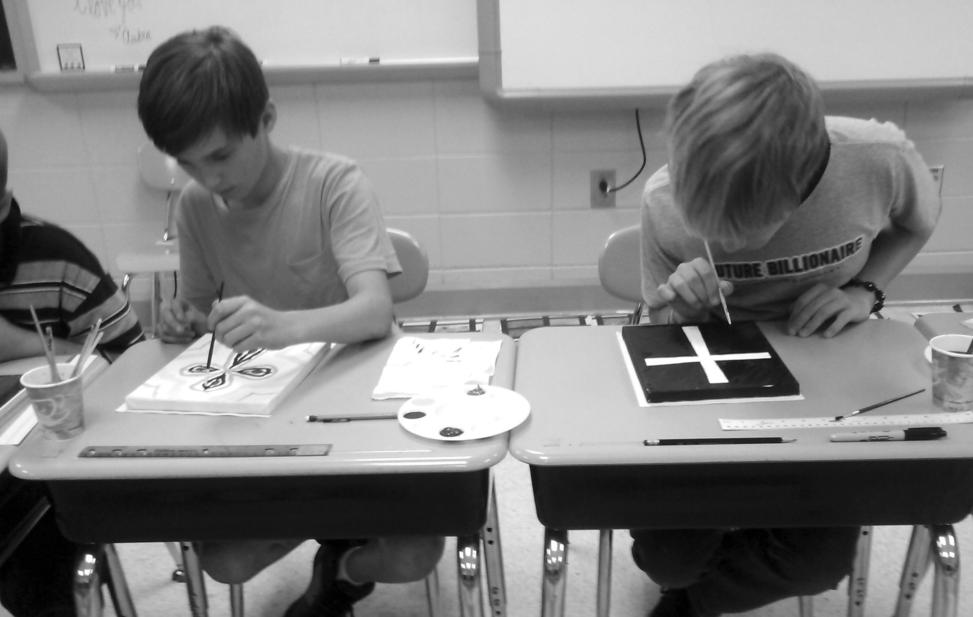 Trevor Hill and Nick McBrayer are working hard at the art camp at Susan Moore Elementary on Tuesday.